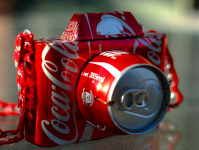 The 355ml/12oz 'standard' can doesn't exactly have the Paparazzi doorstopping it...(Picture Credit: Coke)