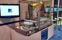 Gebo Cermex debuted its SecurFlow robotic removal system at Pack Expo 2014 this week